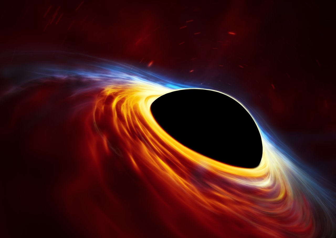 Z rotace černých děr by se dala těžit mimořádně velká energie. Kredit: ESO, ESA/Hubble, M. Kornmesser.